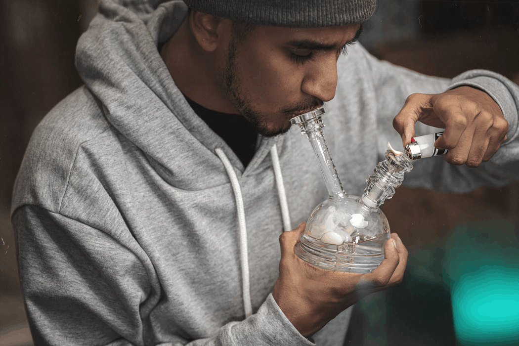 Man learning how does a bong work