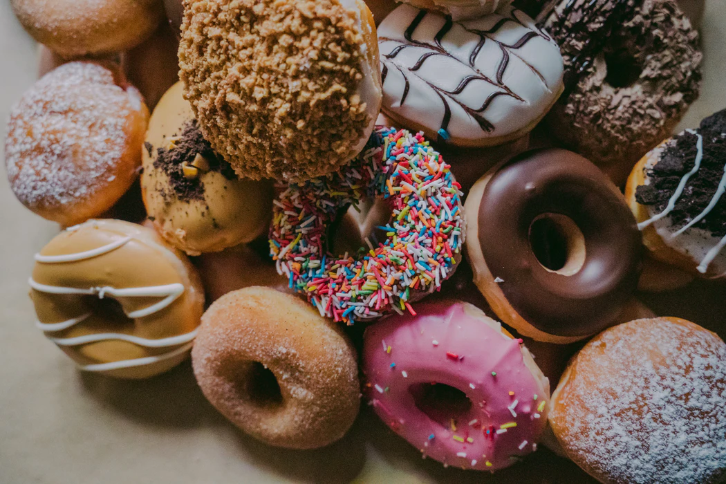 variety of donuts in a pile