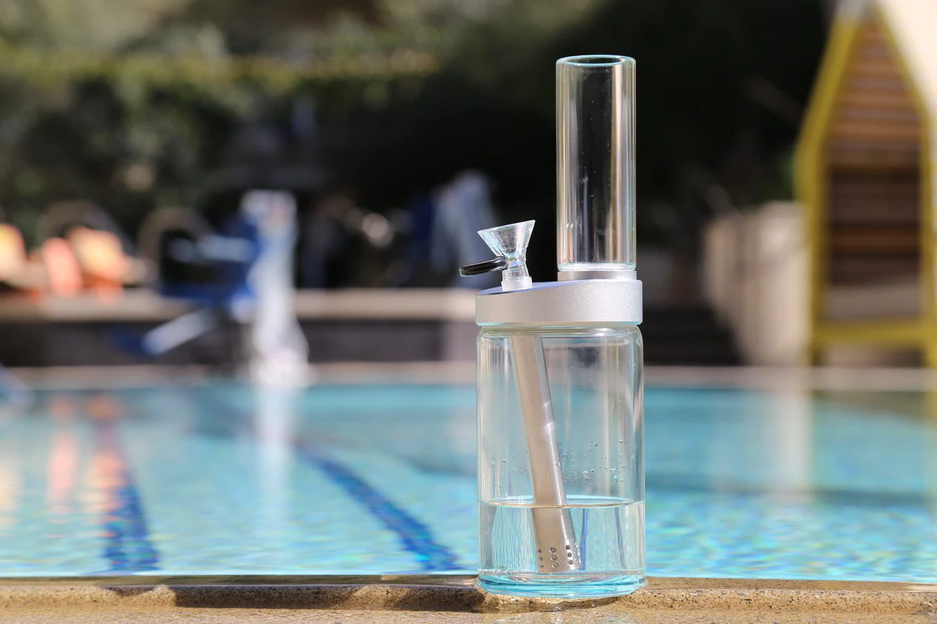 Bong by a pool for learning how to smoke wax