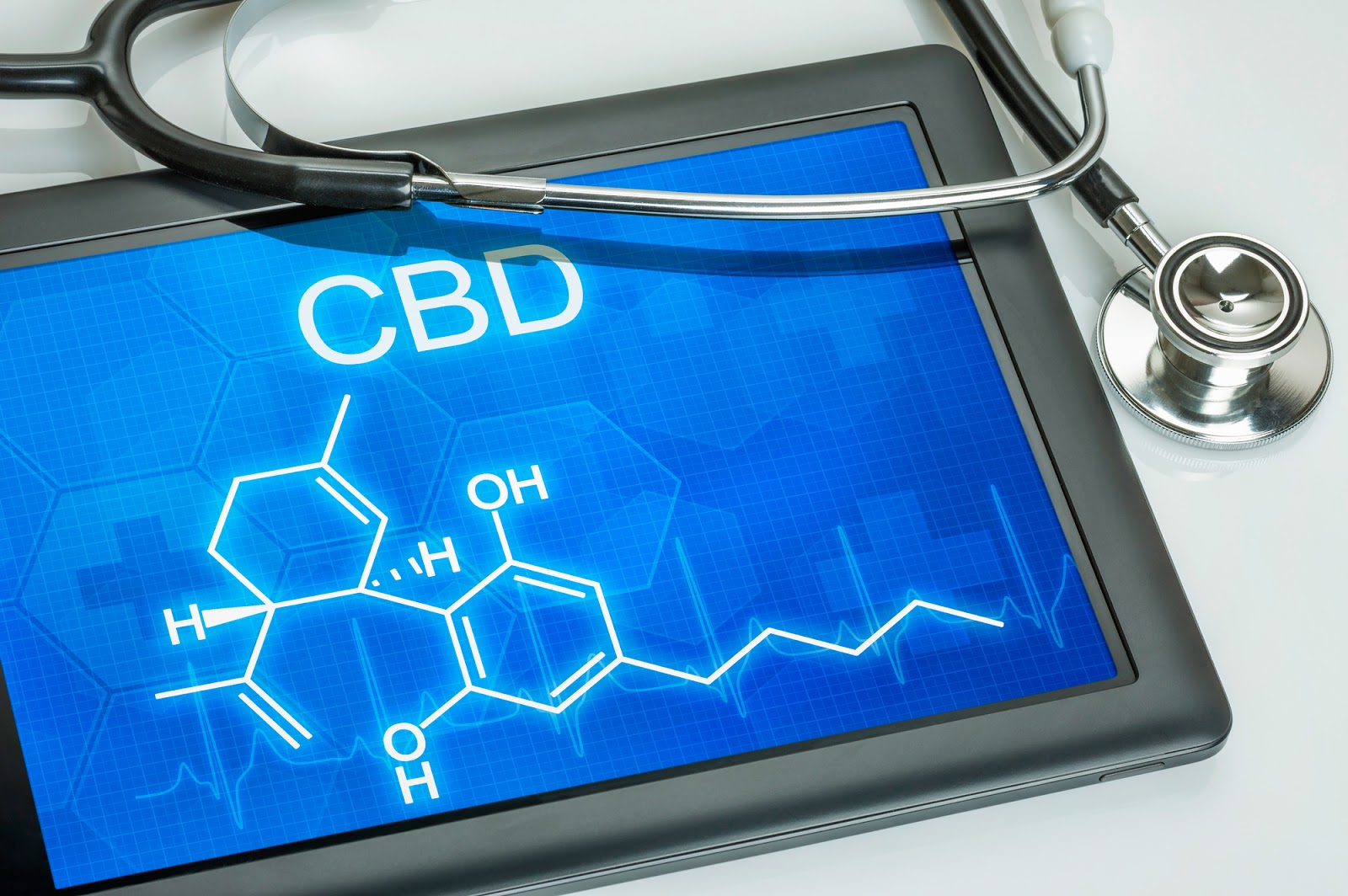 CBD compound on screen next to stethoscope