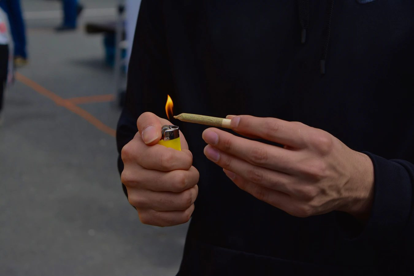 Man lighting up a joint