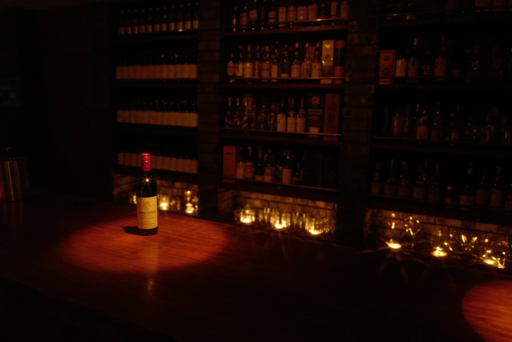 inside a dark candle lit winery